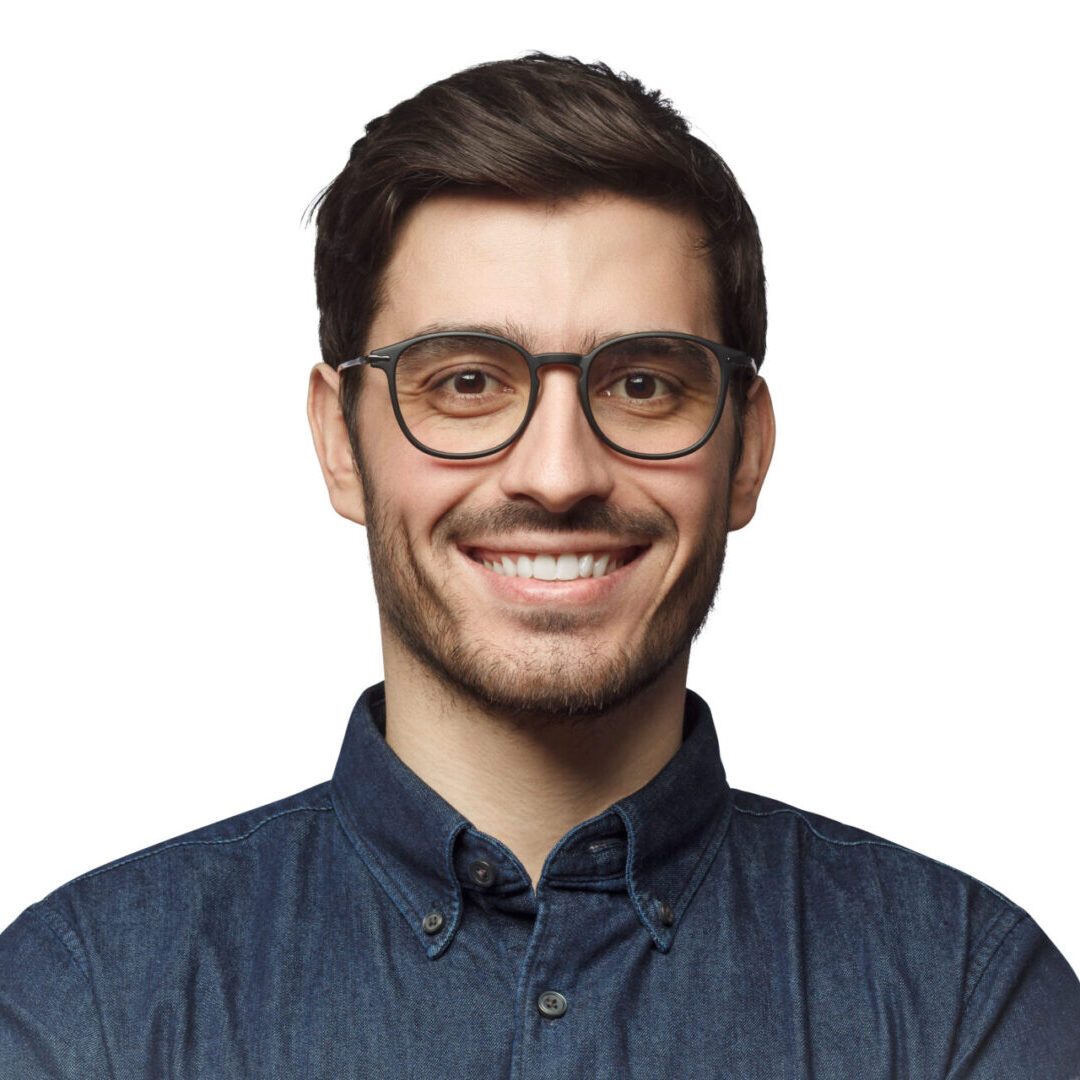 Smiling handsome man with trendy haircut and glasses isolated on white background